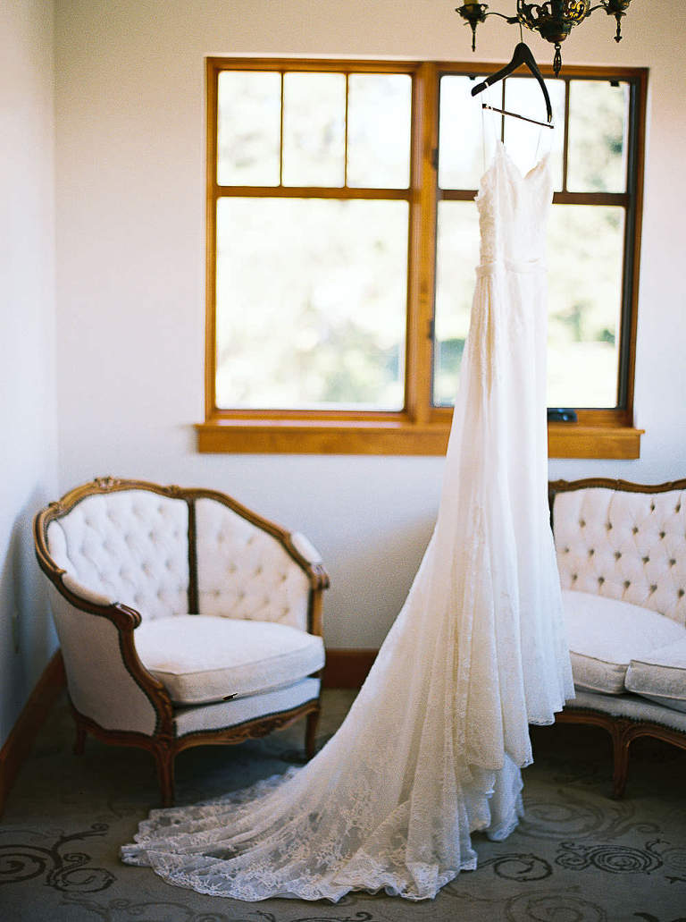 Watters Wedding Gown Hanging at Arbor Crest Winery by Seattle Wedding Photographer Anna Peters