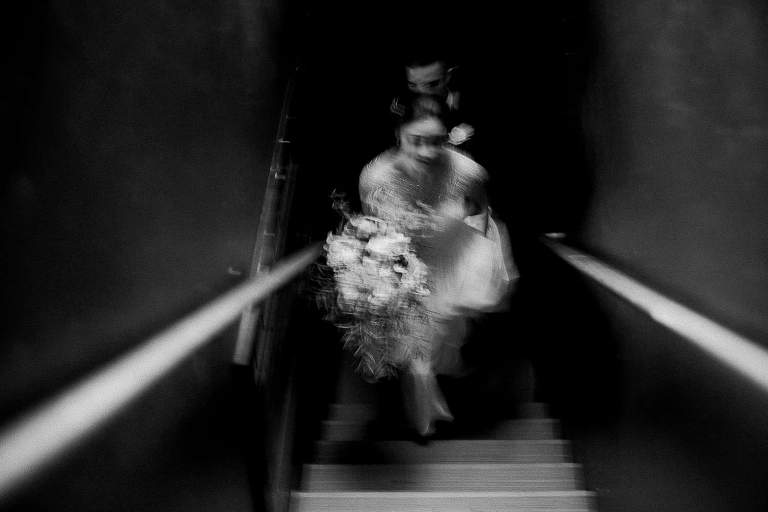 Moody and Emotional Black and White candid image of Bride and Groom walking together by Seattle Film Photographer Anna Peters