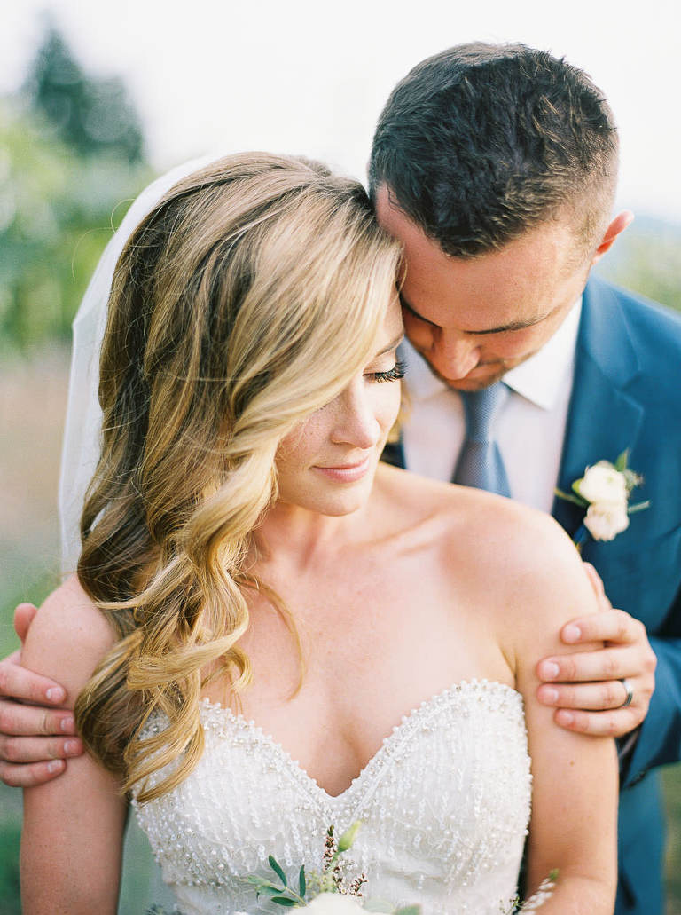 Relaxed and romantic bride and groom golden hour portrait at Arbor Crest Winery by Spokane Wedding Photographer Anna Peters