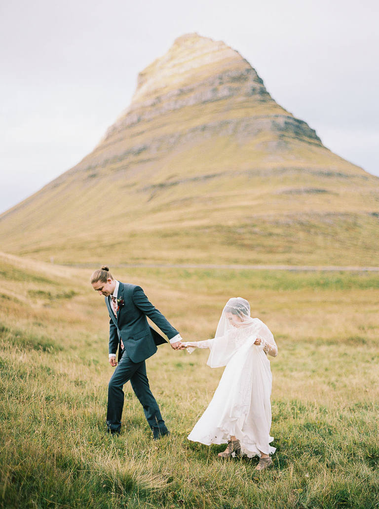 Romantic portrait of bride and groom in Iceland with rue de seine gown by destination wedding photographer Anna Peters