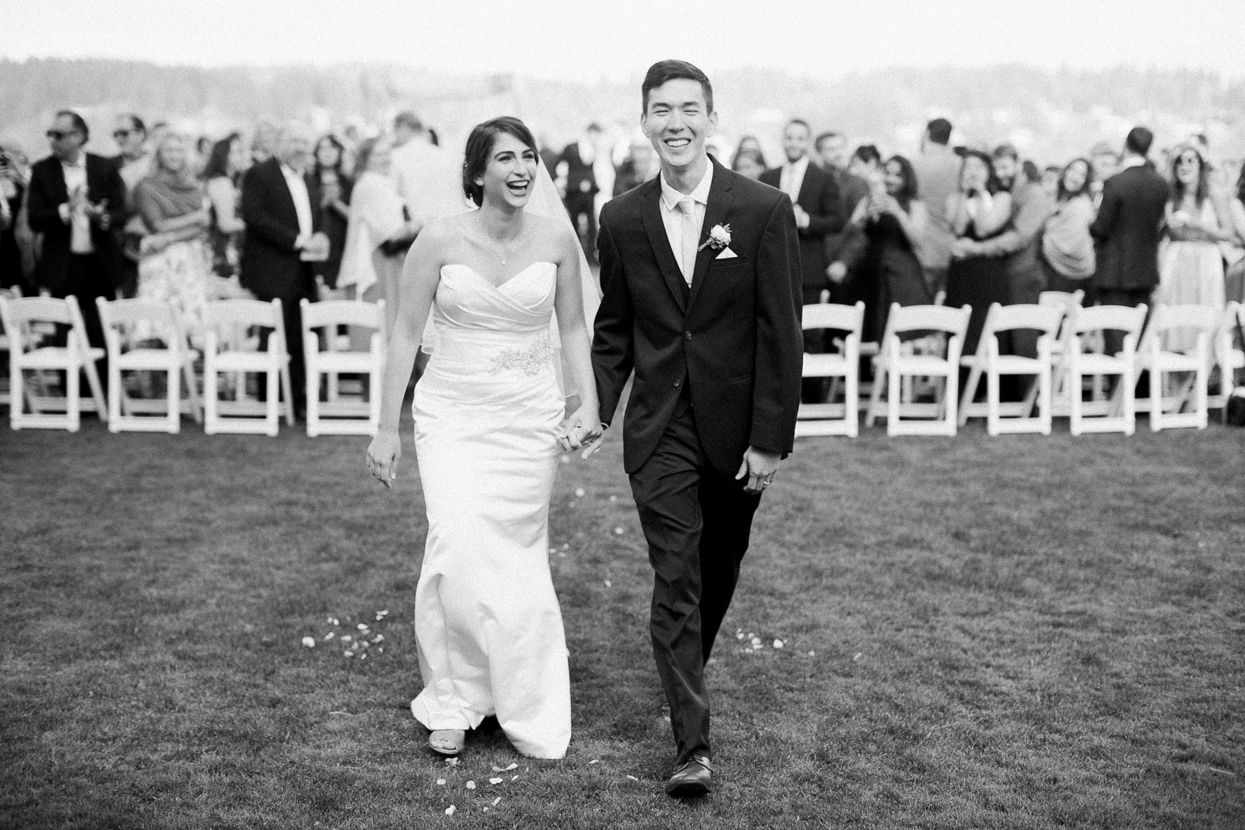 Joyful bride and groom at Kiana Lodge by top Seattle wedding photographer Anna Peters