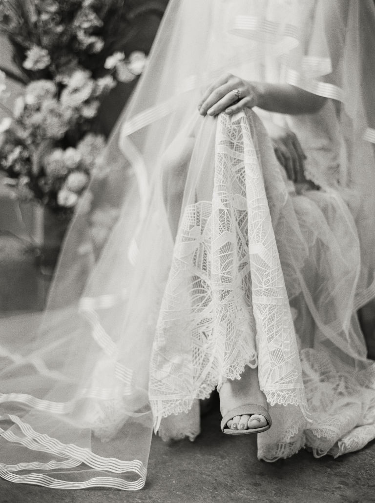 Delicate lace wedding gown at Canvas Event Space in Seattle, by Anna Peters