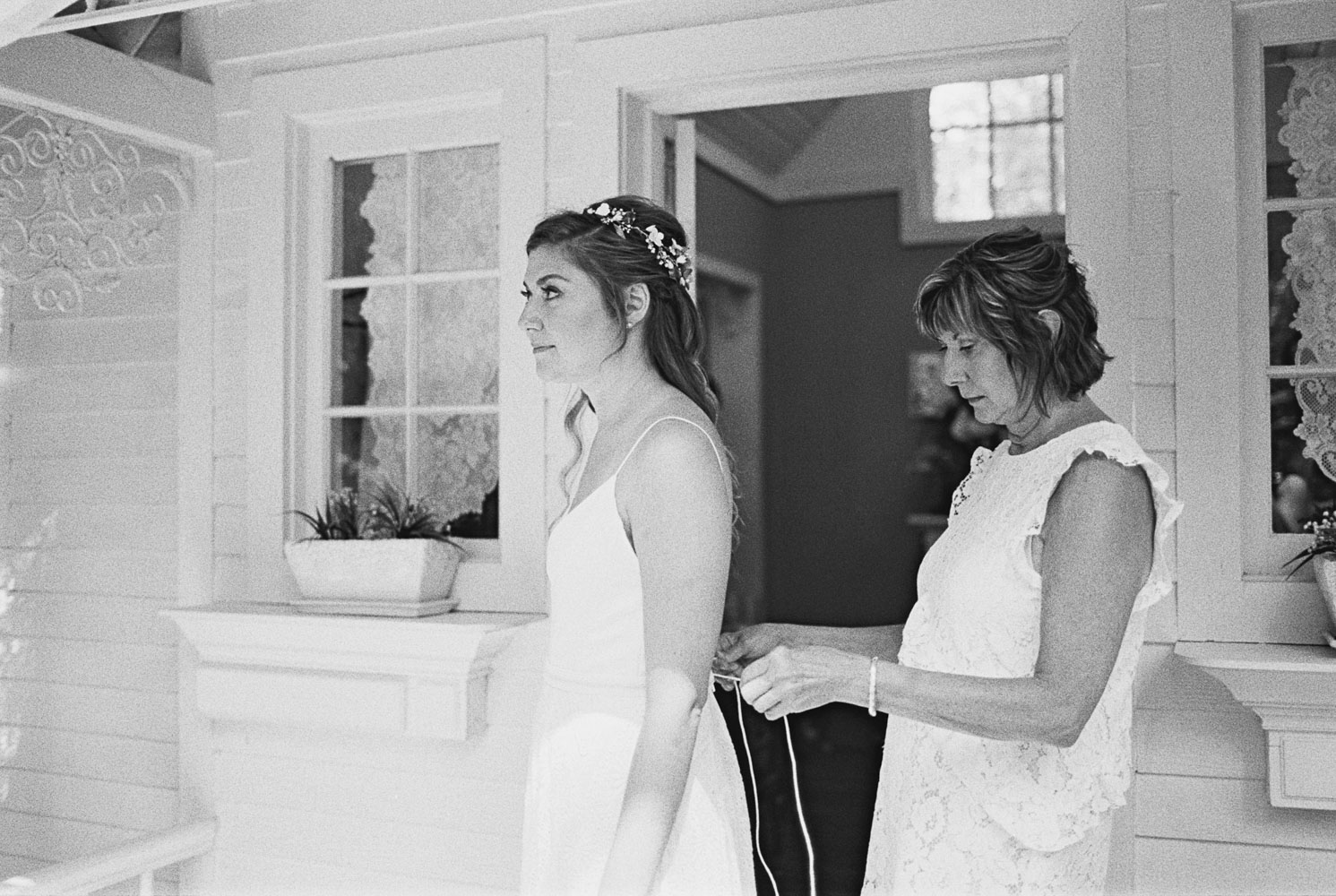 Mom ties bride's dress at Wellspring Spa Wedding Venue near Seattle