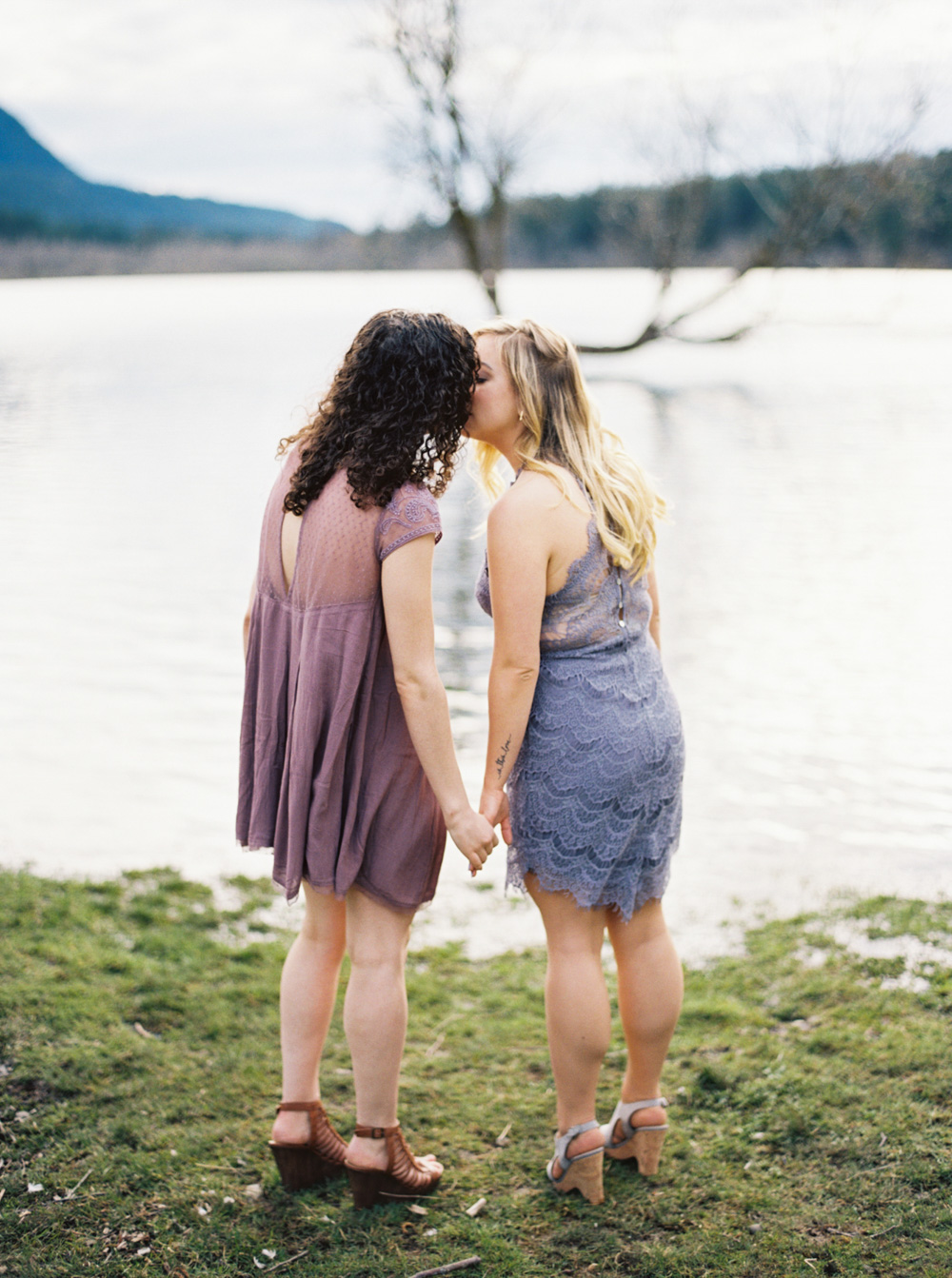 Couple kisses by lake at Rattlesnake ridge Engagement Session by Seattle Wedding Photographer Anna Peters