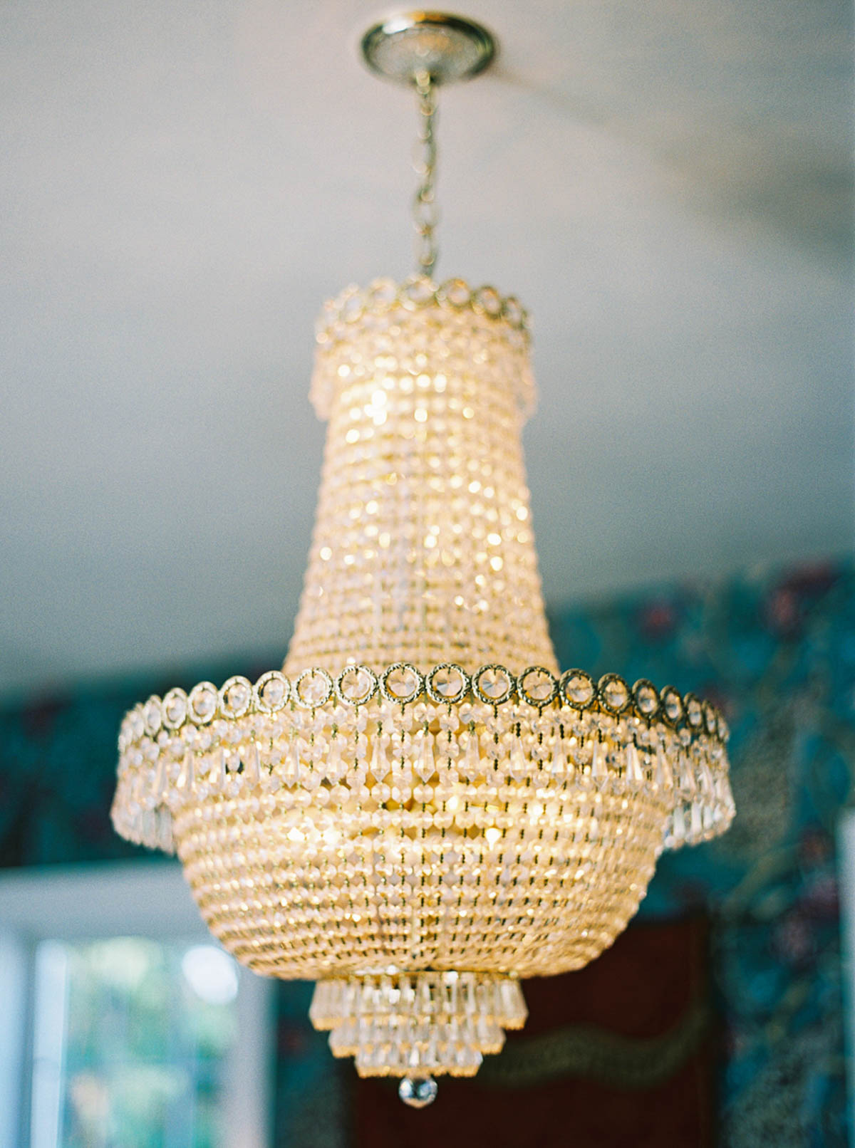 Chandelier detail at a Crockett Farm Wedding, by fine art film wedding photographer Anna Peter
