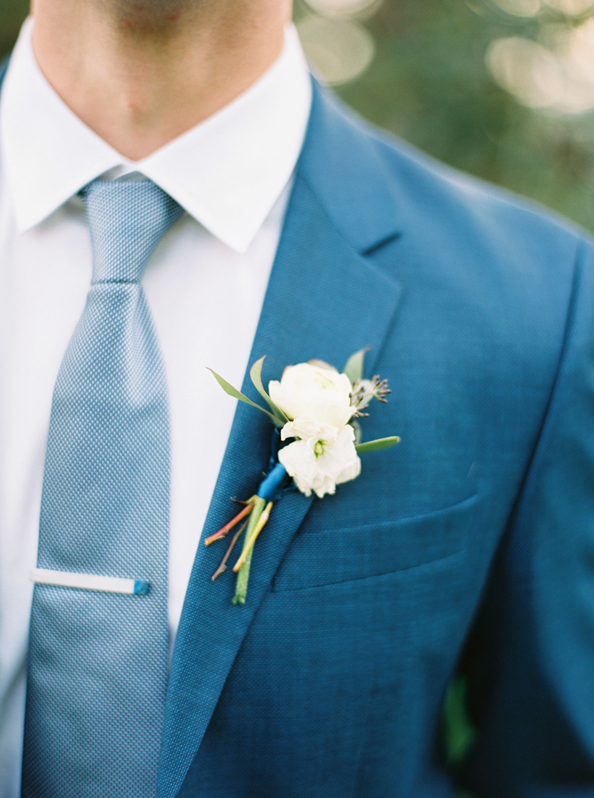 Groom in a navy suit at Arbor Crest Winery by top Spokane Wedding Photographer Anna Peters