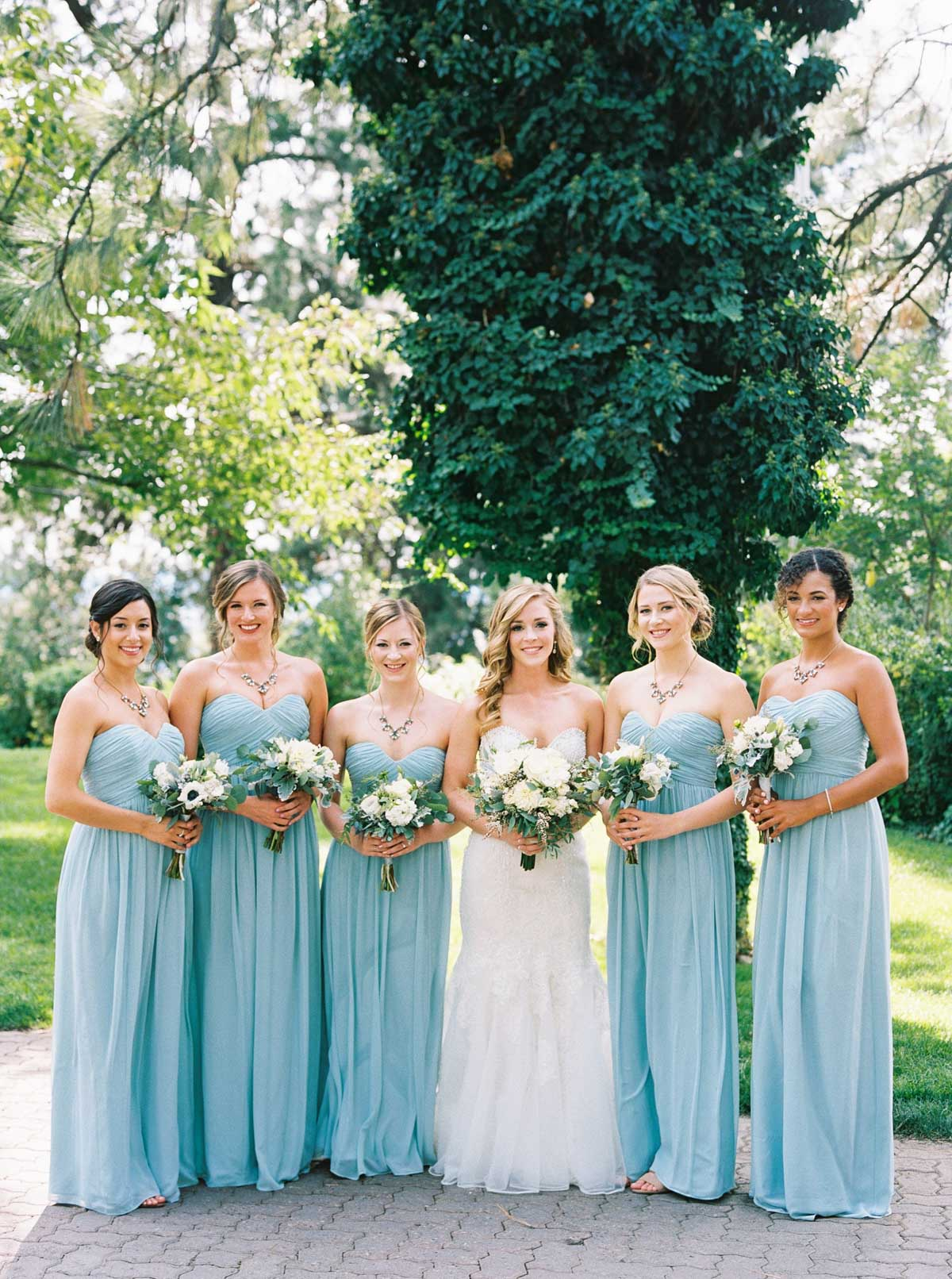 Bridesmaids in light blue at Arbor Crest Winery by top Spokane Wedding Photographer Anna Peters