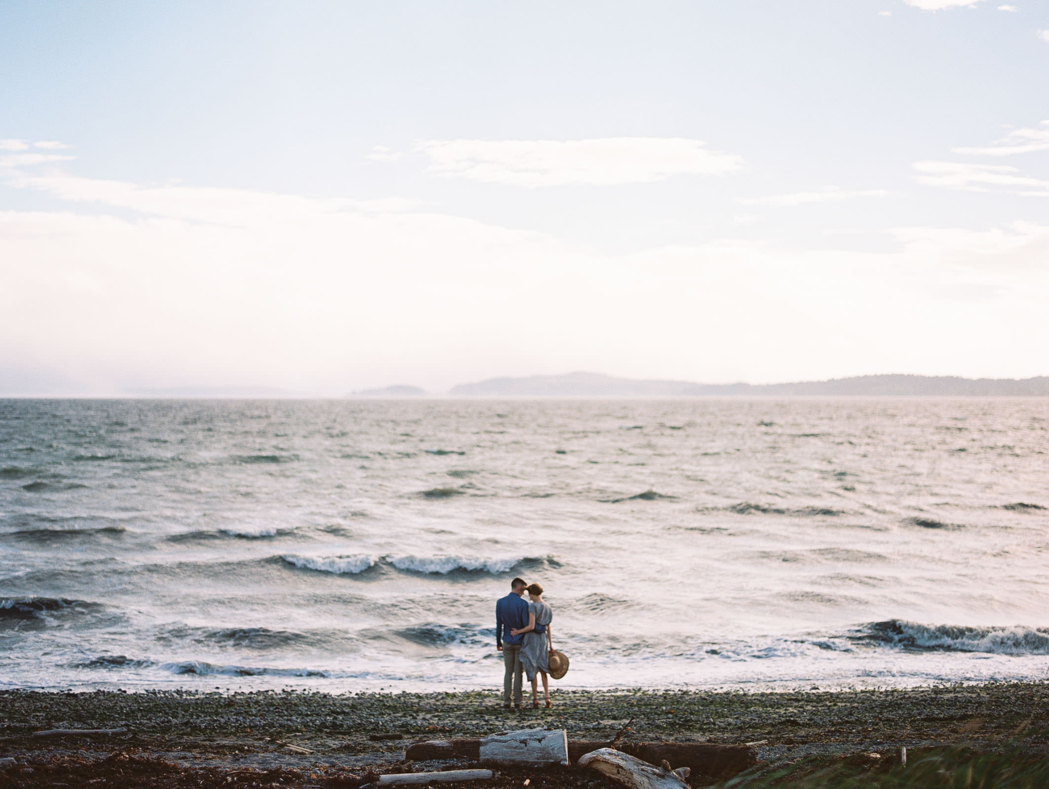 Romance on the water at Discovery Park by Seattle Engagement Photographer Anna Peters