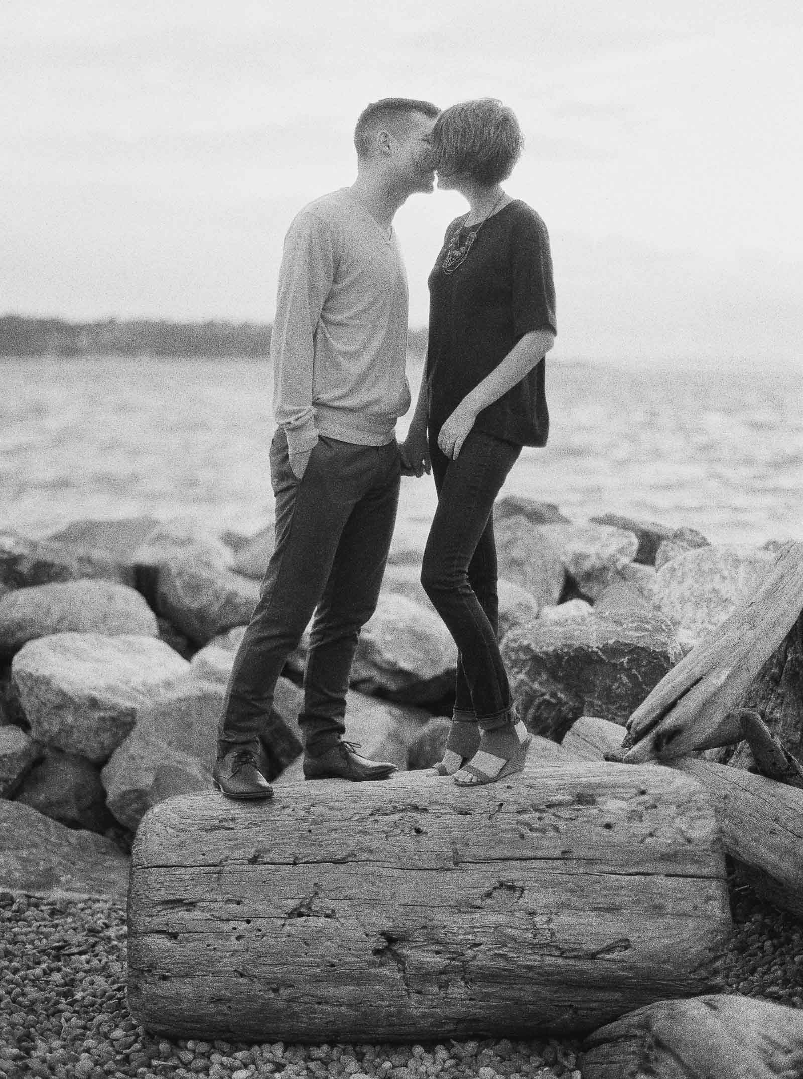 Romantic kiss on the Seattle Waterfront captured on Film by Seattle Engagement photographer Anna Peters