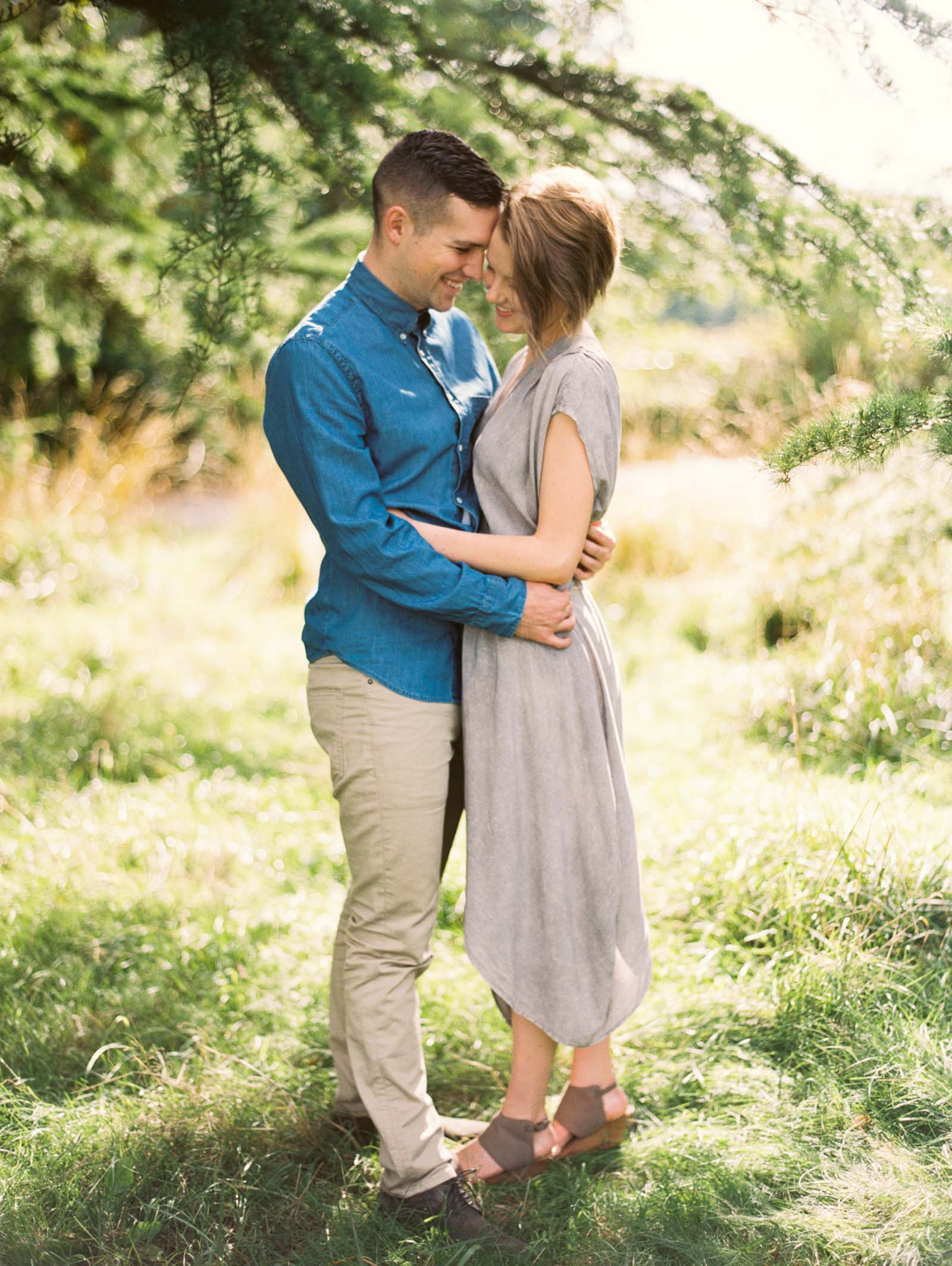 A romantic embrace at discovery park captured on film by top Seattle Engagement Photographer Anna Peters