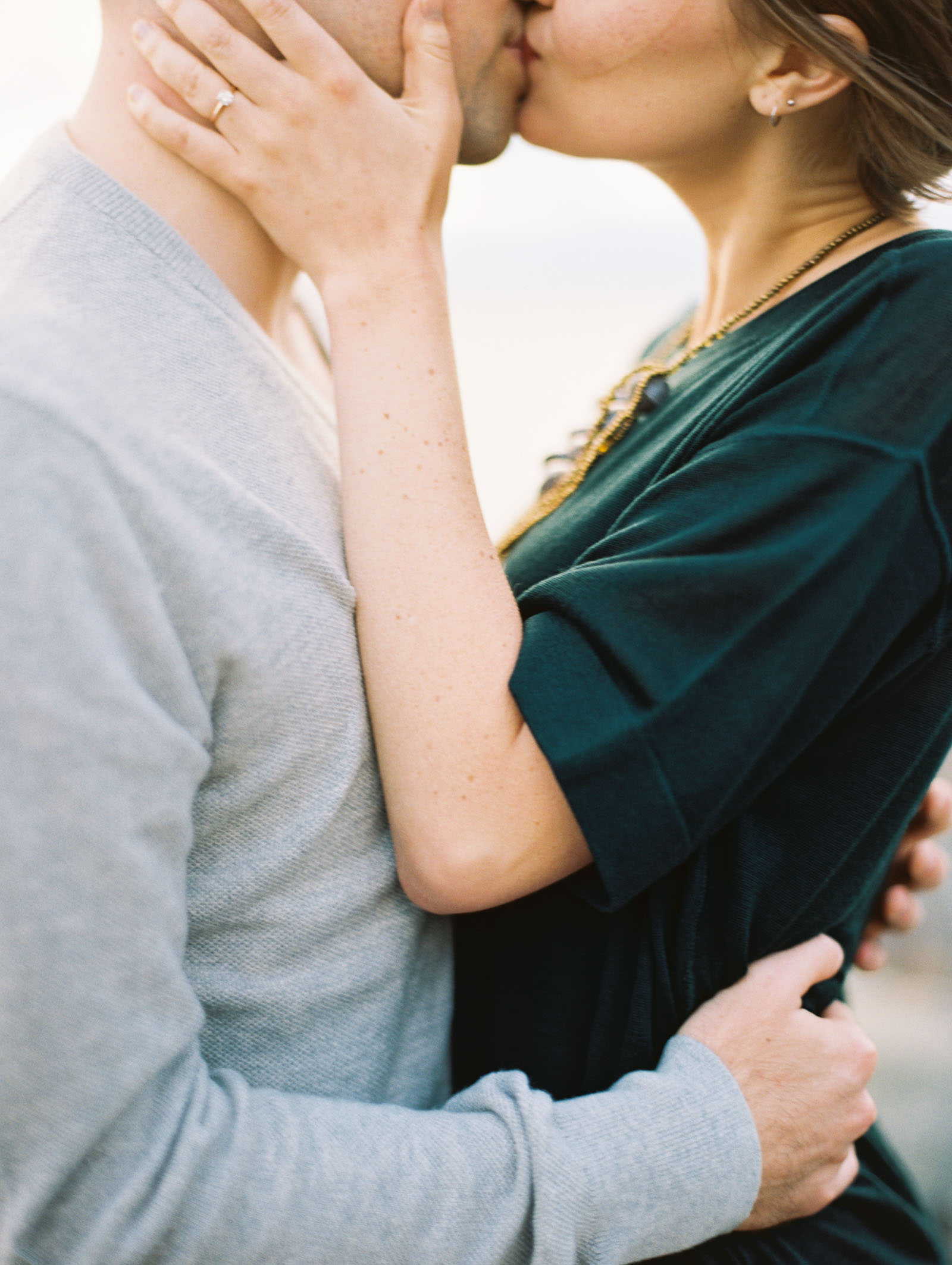 Romantic Kiss by the water captured by Seattle Engagement Photographer Anna Peters