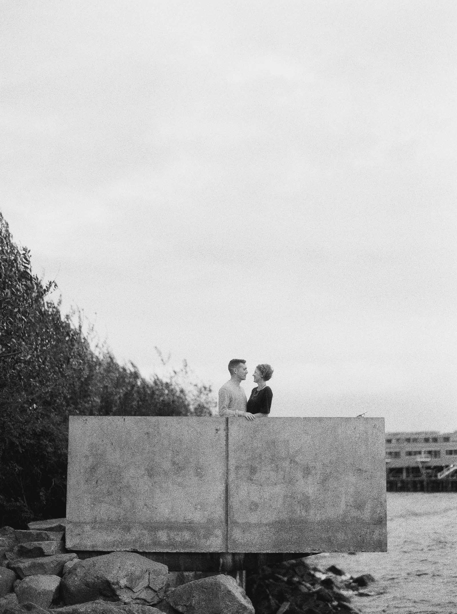 Classic black and white film photography on the Seattle waterfront by Seattle Engagement photographer Anna Peters