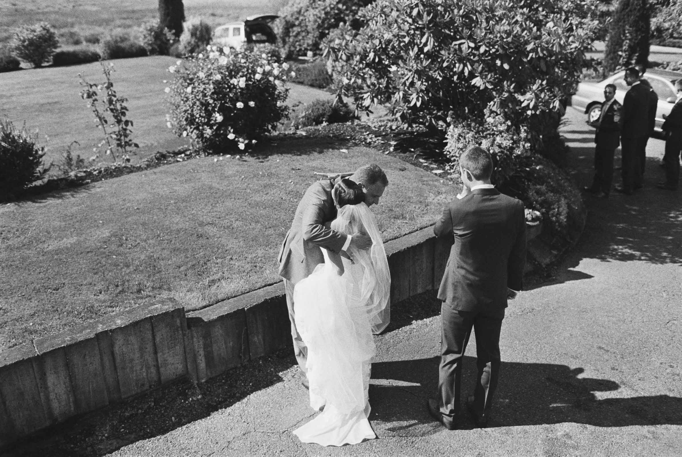 A candid embrace at Lord Hill Farms captures by Seattle Wedding Photographer Anna Peters