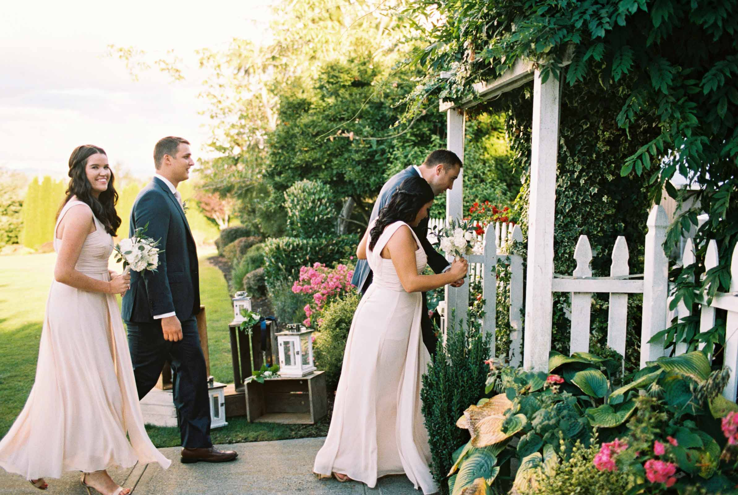 Bridesmaids and groomsmen leave a wedding ceremony at Lord Hill Farms