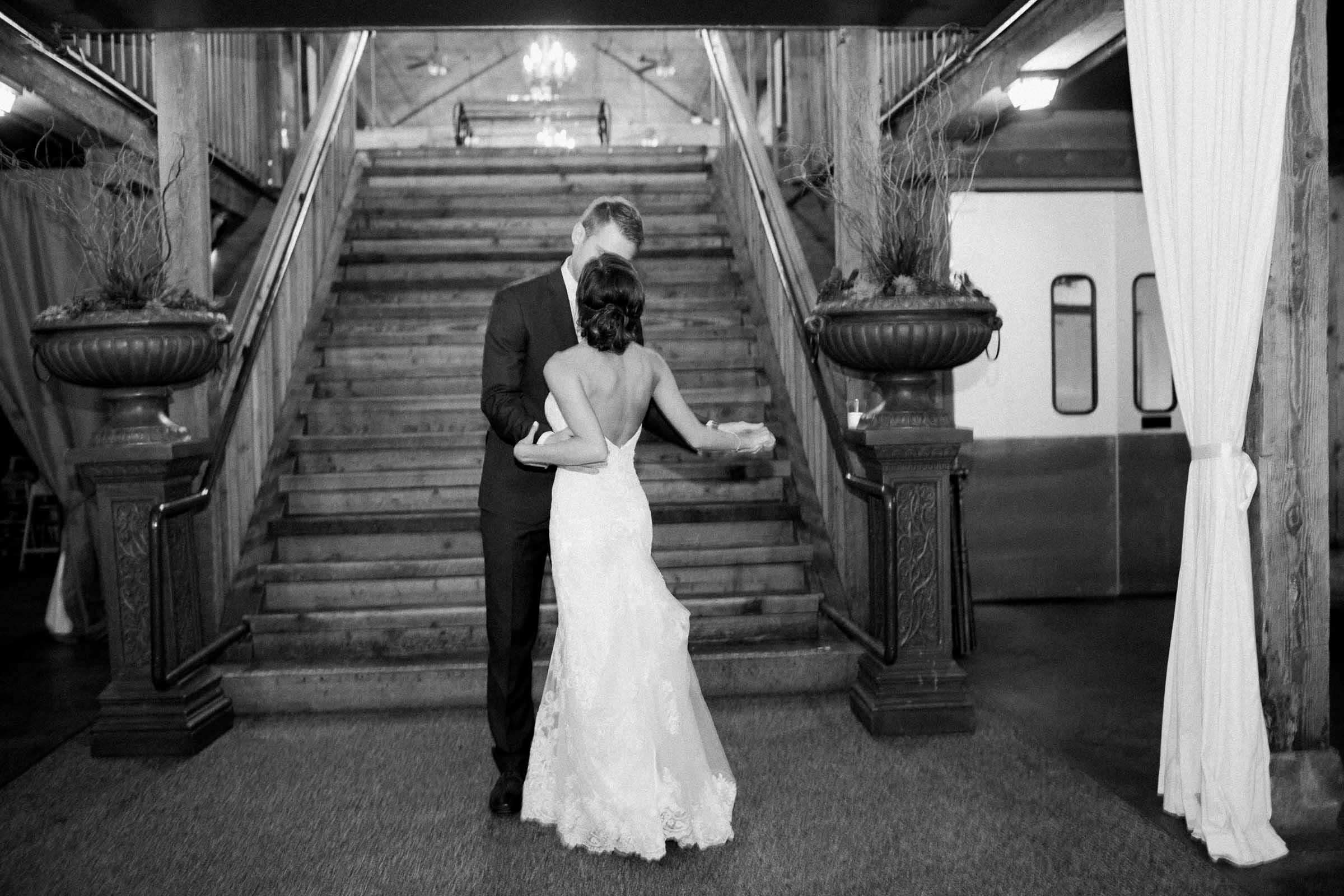 Bride and groom enter their wedding reception in the barn at Lord Hill Farms
