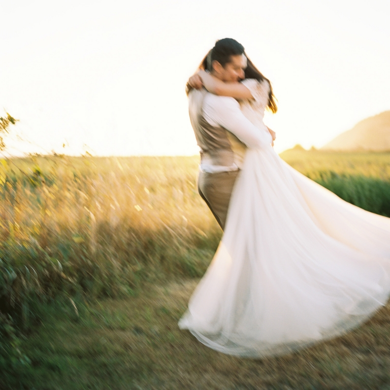 Bride and groom dancing at sunset on Whidey Island captured by film photographer Anna Peters