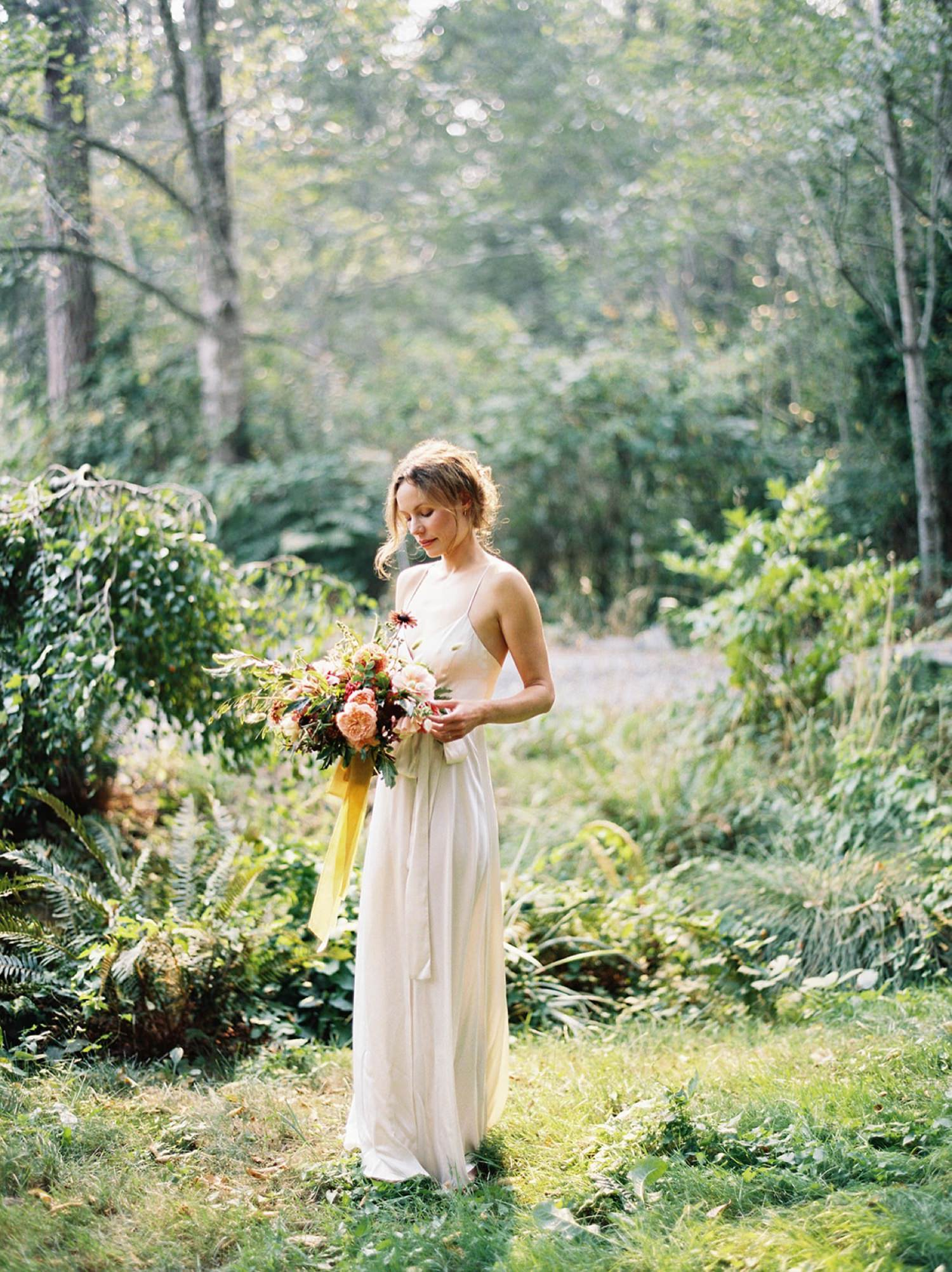 Bride with colorful, garden inspired bouquet at an intimate backyard wedding on Bainbridge Island