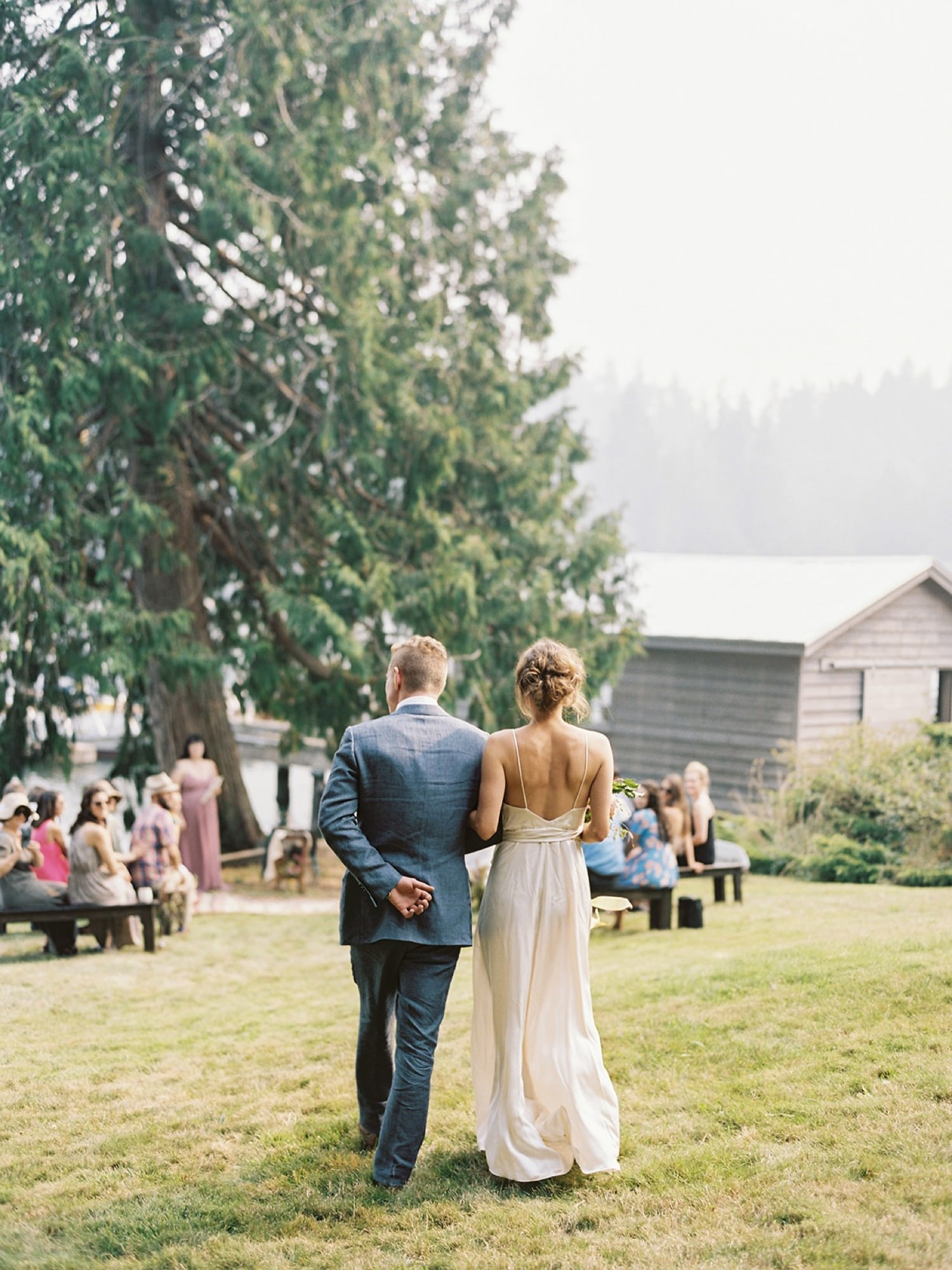 Bride and groom enter together at an intimate wedding on Bainbridge Island
