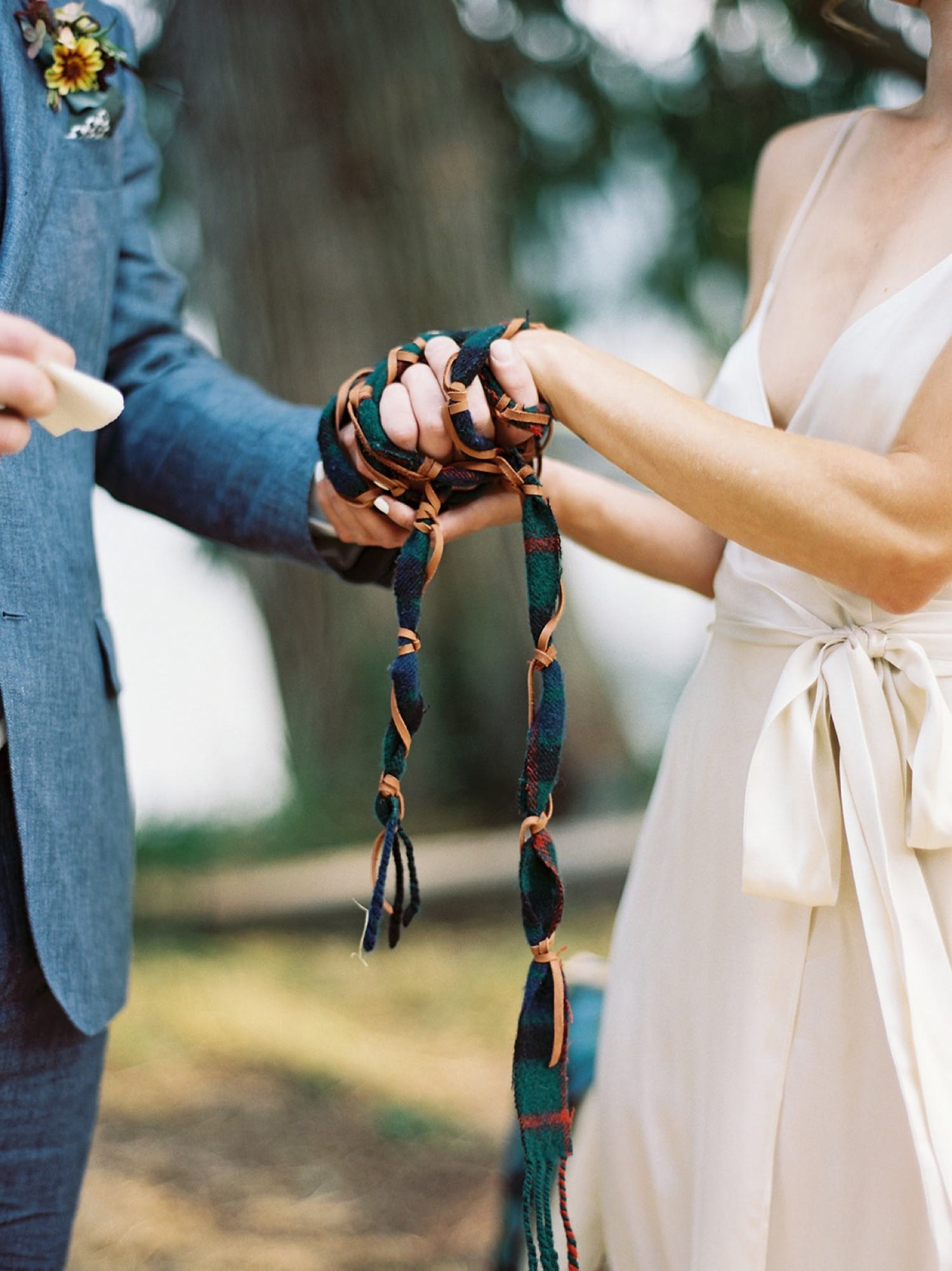 Handfasting ceremony at an intimate backyard wedding captured by Anna Peters