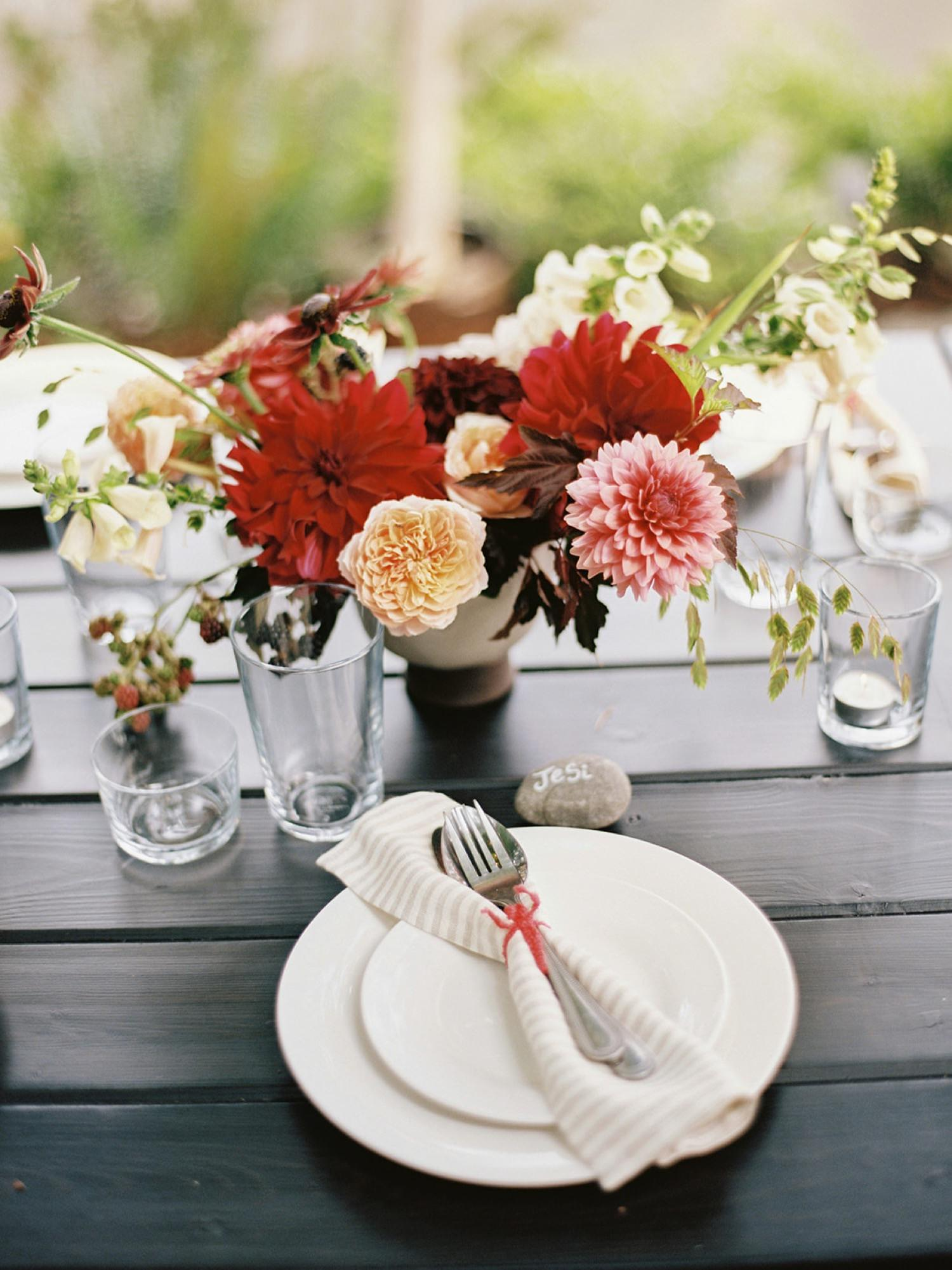 Colorful, simple table setting at a backyard wedding